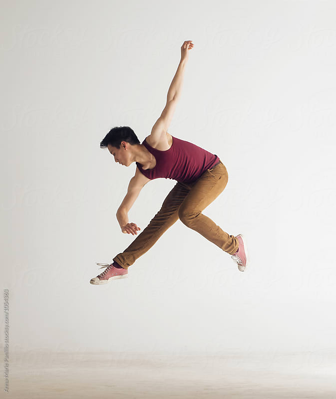 Young asian male dancer mid-air by Anna-Marie Panlilio for Stocksy United
