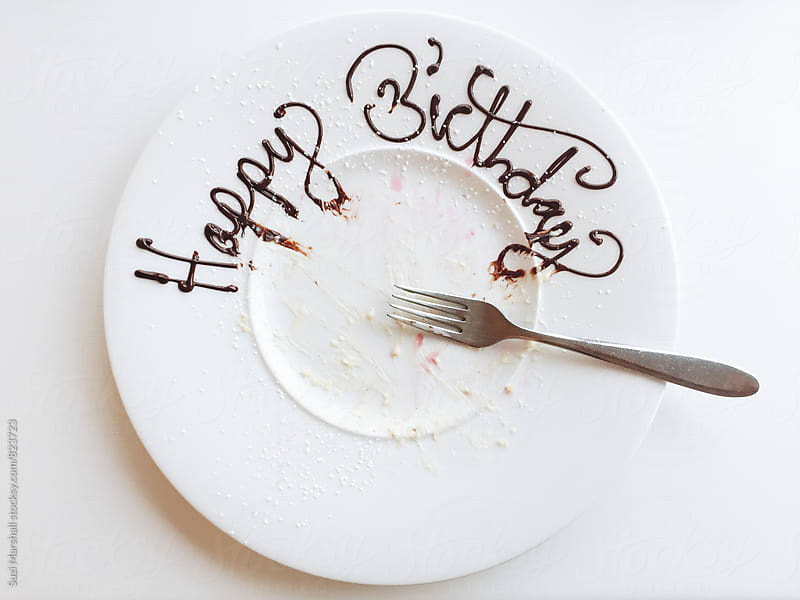Empty plate with happy birthday written in icing by Suzi Marshall for Stocksy United