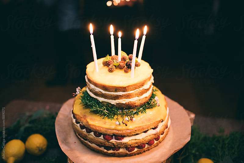 Naked Rustic wedding cake by Adrian Cotiga for Stocksy United