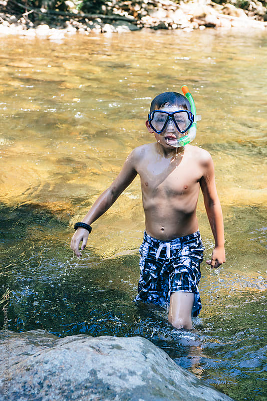 Boy Going River Snorkeling by Ronnie Comeau for Stocksy United