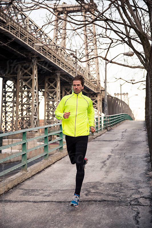 Male runner running on path next to Manhattan bridge by Ann-Sophie Fjelloe-Jensen for Stocksy United
