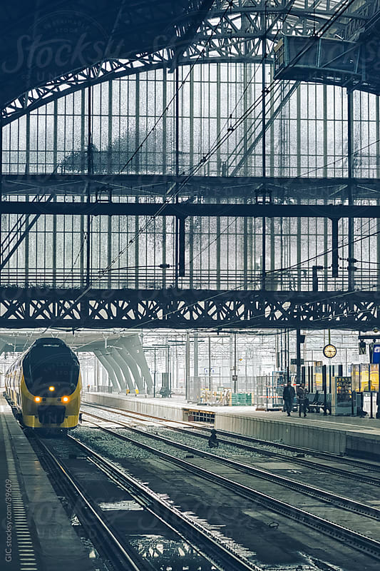 Train in Amsterdam Central Station by Simone Becchetti for Stocksy United