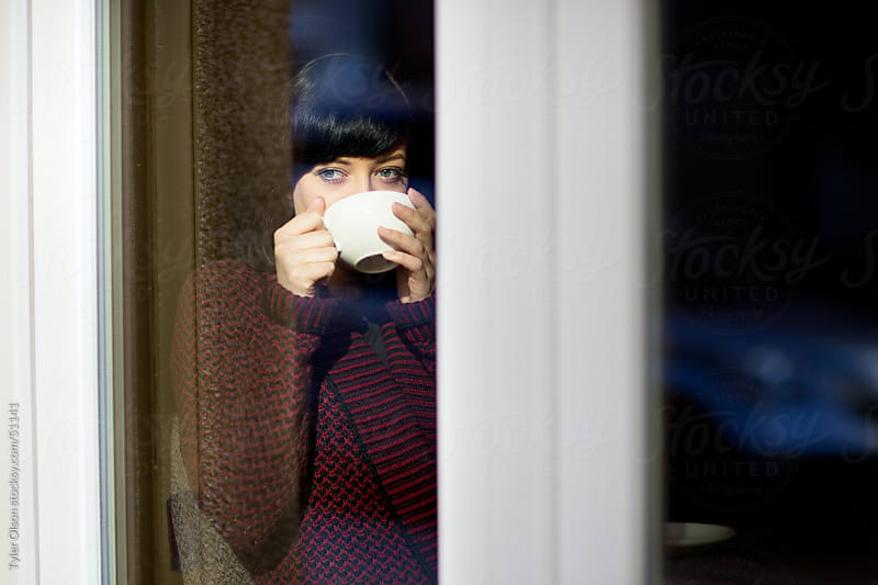 Woman With Hot Drink Cafe Window by Tyler Olson for Stocksy United