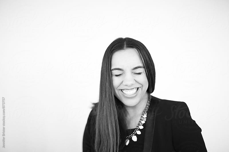 Young woman laughing by Jen Brister for Stocksy United
