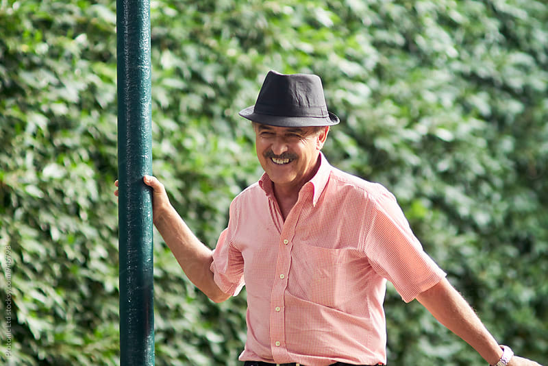 Handsome happy grandfather in a park by Per Swantesson for Stocksy United