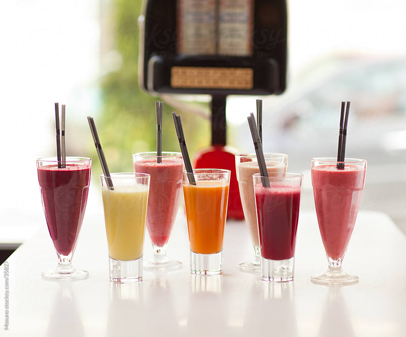 Bunch of colorful smoothies and shakes served in a restaurant. by Mosuno for Stocksy United