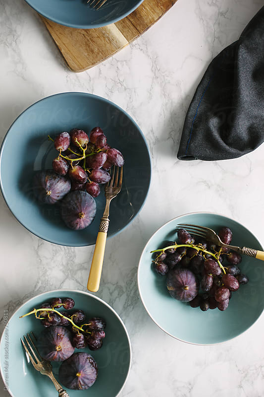 Healthy breakfast: Figs and black grapes. by Darren Muir for Stocksy United