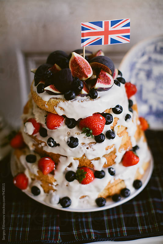 Sweet cake with cream and berries by Sergey Filimonov for Stocksy United