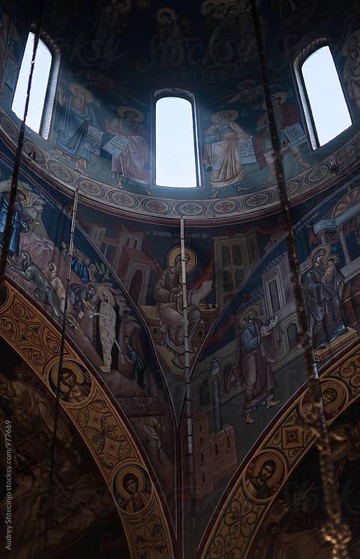 Dome windows shines interior full of fresco of Jovan Vladimir church/first Serbian Saint. by Audrey Shtecinjo for Stocksy United