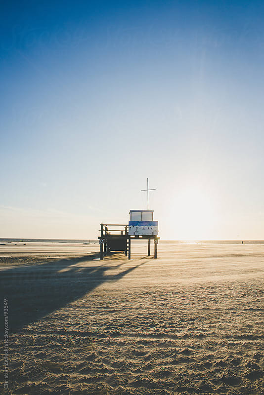 Rescue high seat on sunset at a lonely beach by Christian Zielecki for Stocksy United
