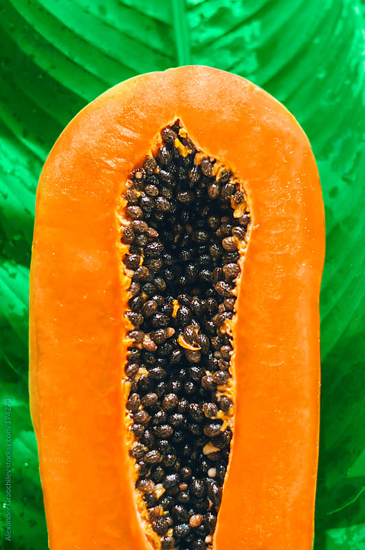 Papaya Half Cut With Seeds Inside by Alexander Grabchilev for Stocksy United