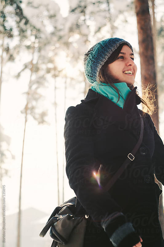 Smiling beautiful girl with winter clothes by Borislav Zhuykov for Stocksy United
