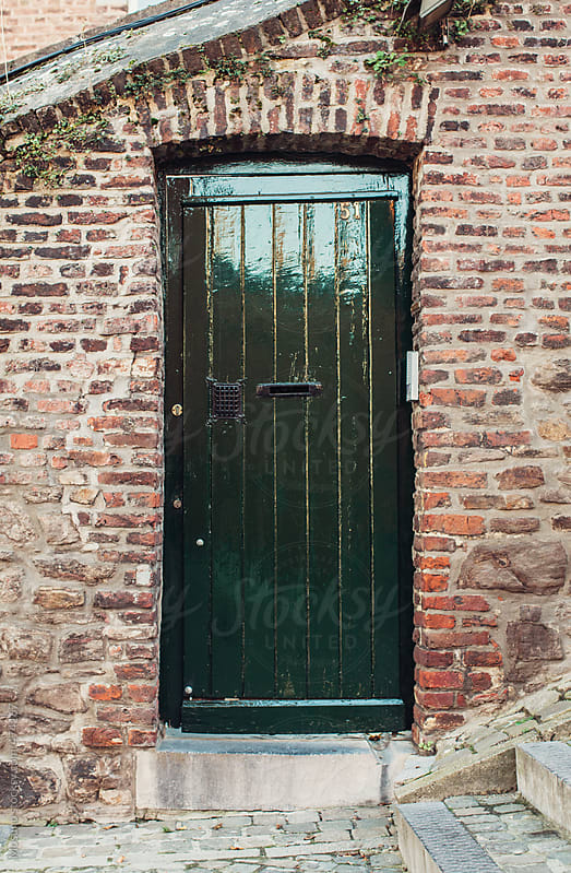 Green Door on the Brick Wall by Mosuno for Stocksy United