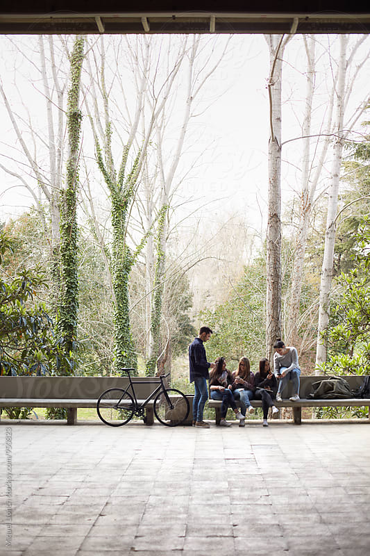 Hang out of a group of students in the campus  by Miquel Llonch for Stocksy United