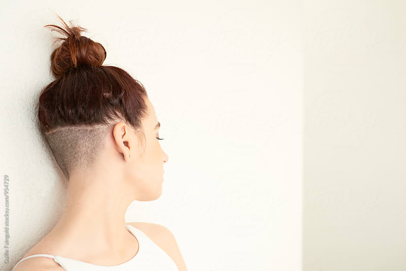 Side view of woman with unusual hairstyle by Guille Faingold for Stocksy United