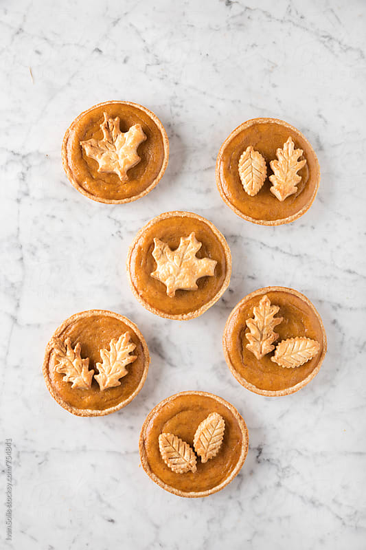 Mini pumpkin pies by Ivan Solis for Stocksy United