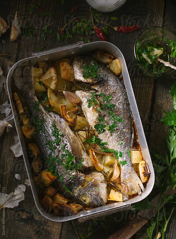 Bream with roasted potatoes by Davide Illini for Stocksy United
