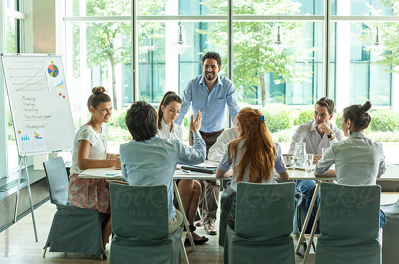 Young People in a Business Meeting by Mosuno for Stocksy United