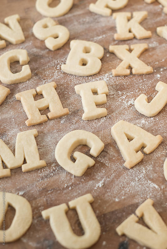 Shortbread Cookie Letters scattered on surface by Kathryn Swayze for Stocksy United