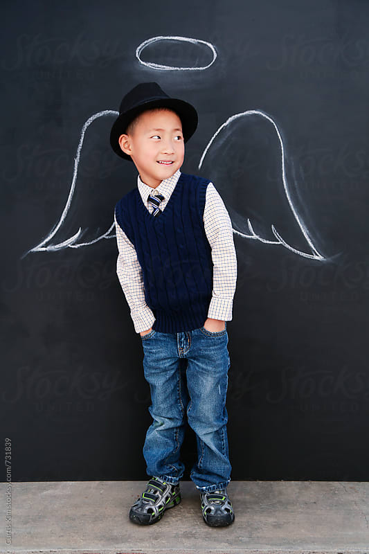 Little asian boy with angel wings and halo by Curtis Kim for Stocksy United