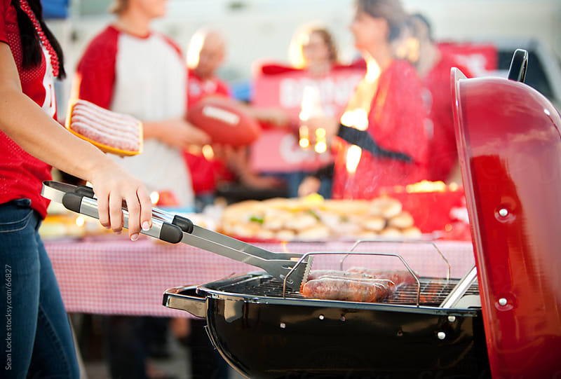 Tailgating: Cooking Up Sausages For Party by Sean Locke for Stocksy United