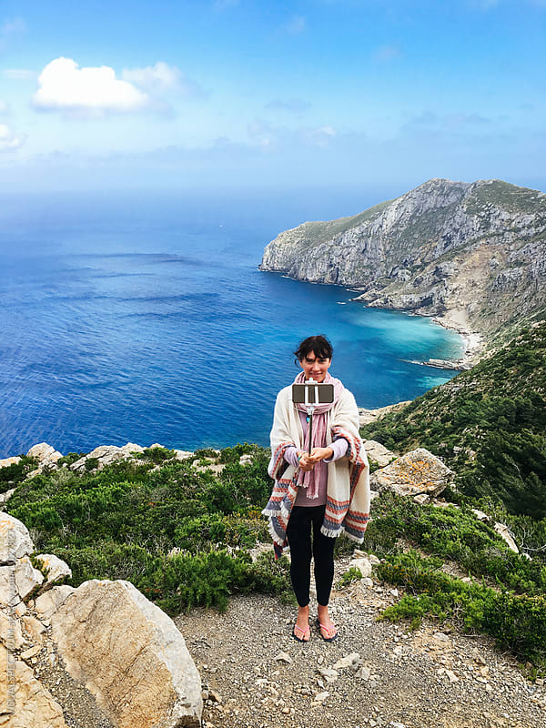 Woman Taking Selfie With Selfie Stick on Sicilian Island Hike by VISUALSPECTRUM for Stocksy United