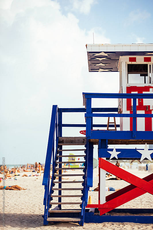 Lifeguard cabin with United States flag decoration in South Beach, Miami by Alejandro Moreno de Carlos for Stocksy United
