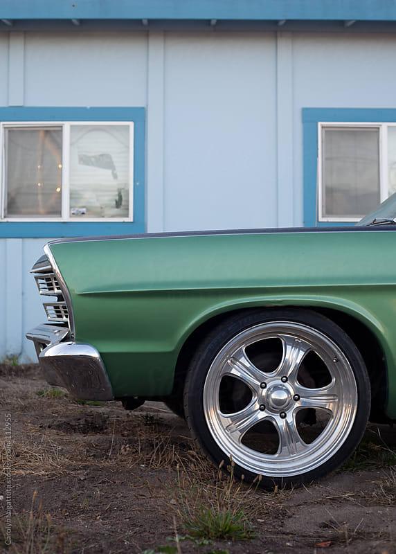 Fender of a green, classic ranch wagon with big silver wheels by Carolyn Lagattuta for Stocksy United