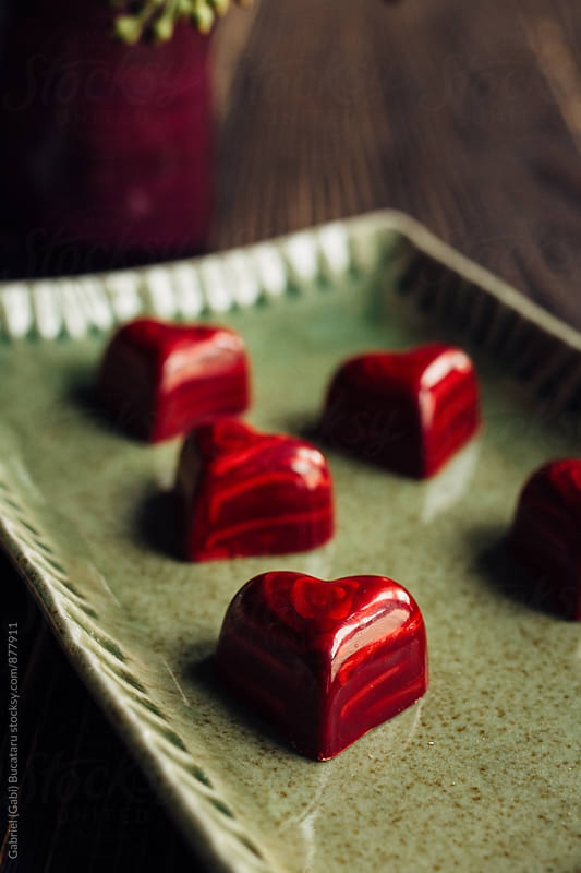 Close up of red heart shaped chocolates by Gabriel (Gabi) Bucataru for Stocksy United
