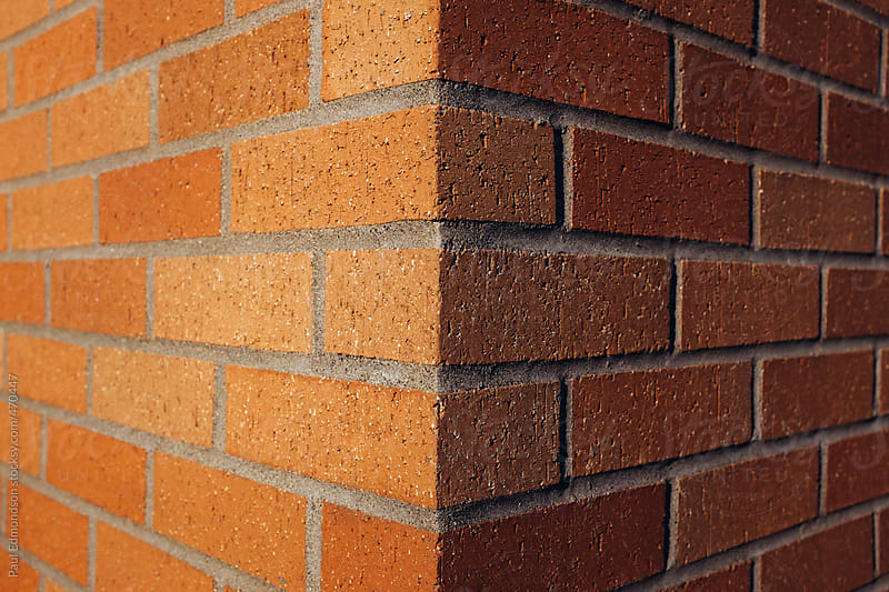 Corner of brick wall by Paul Edmondson for Stocksy United