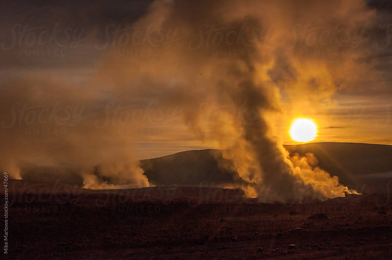 A sunrise shot of steam rising from the ground by Mike Marlowe for Stocksy United