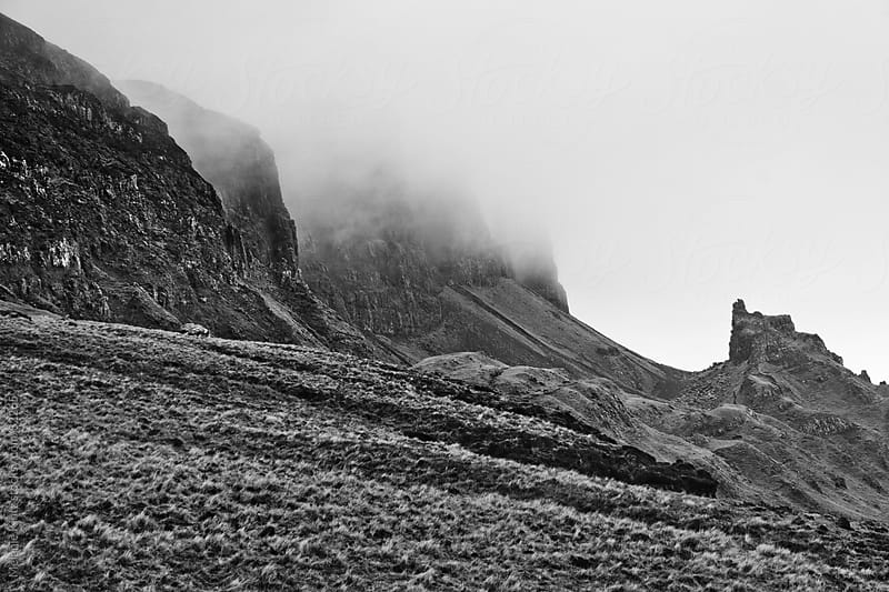 Quiraing in Scotland with fog rolling over by Melanie Kintz for Stocksy United