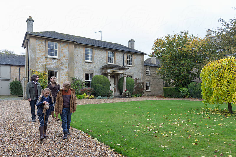 Family leaving country house. by Paul Phillips for Stocksy United