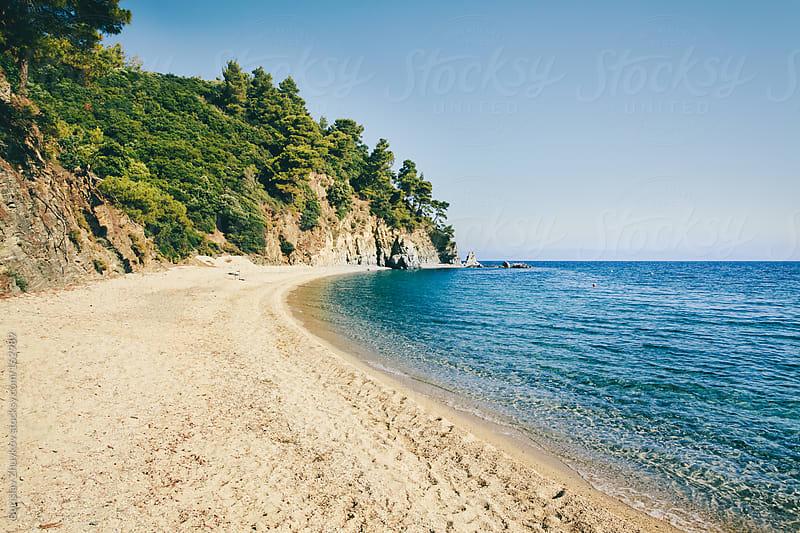Empty beach in the summer by Borislav Zhuykov for Stocksy United