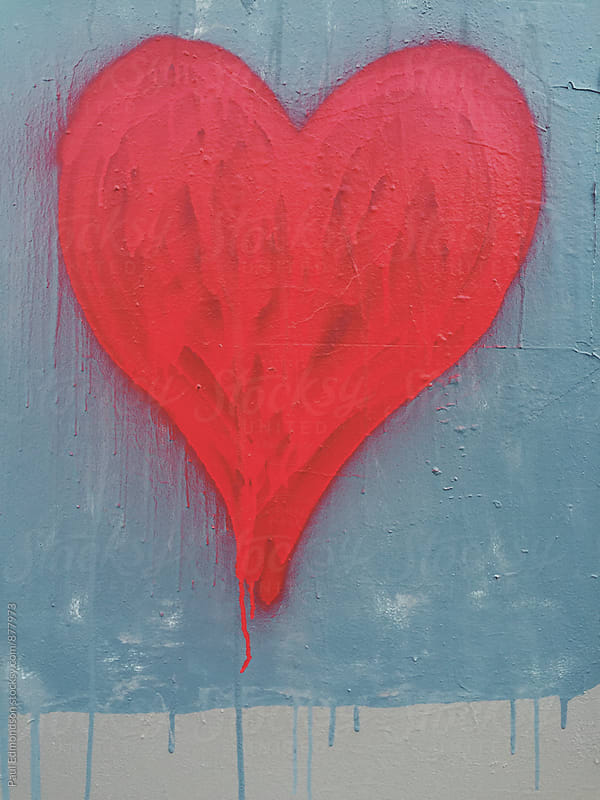 Red spray painted heart shape on wall by Paul Edmondson for Stocksy United