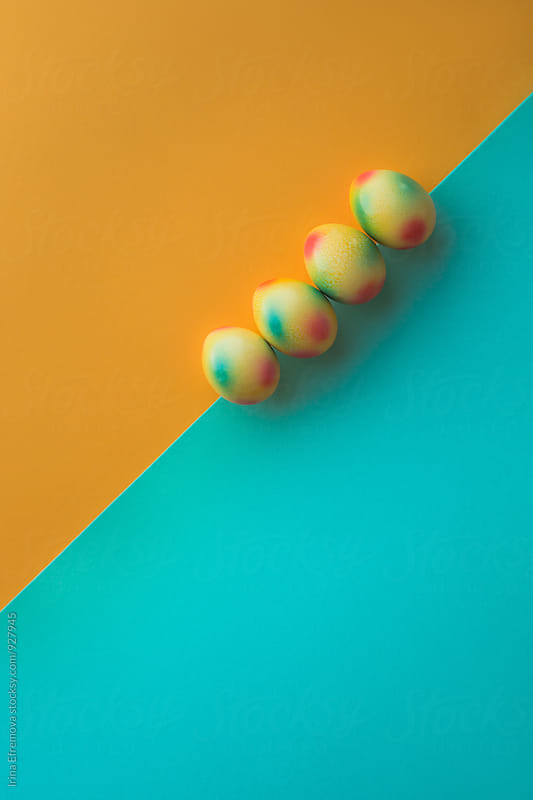 Yellow and turquoise Easter eggs by Irina Efremova for Stocksy United