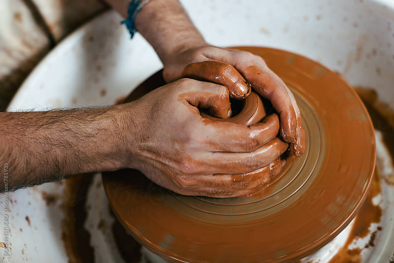 Ceramist working on a potter's wheel.  by BONNINSTUDIO for Stocksy United