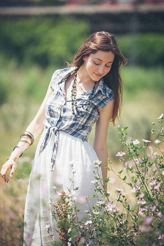 Smiling Woman in a Field by Lumina for Stocksy United