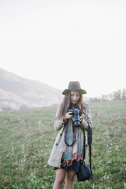 Female Photographer Holding Camera by Aleksandra Jankovic for Stocksy United