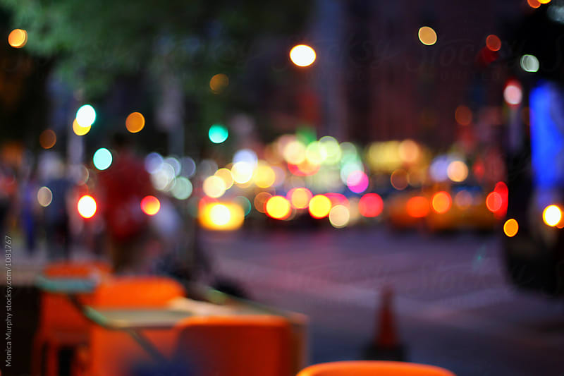 Blurred lights of the city at night by Monica Murphy for Stocksy United