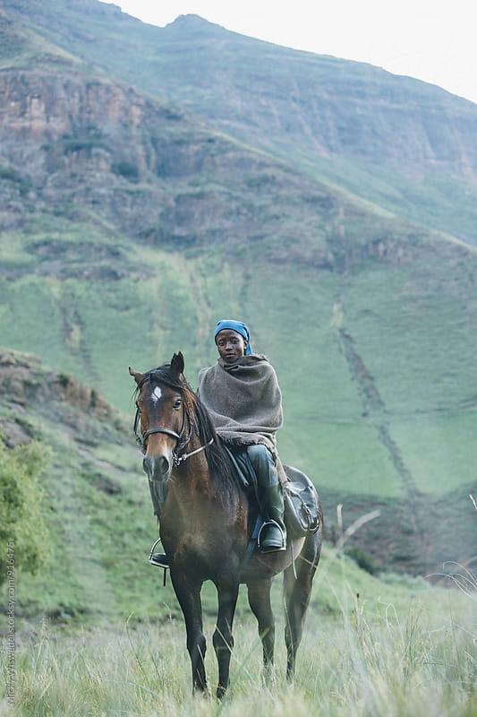 Young African Basotho herdsman with his horse by Micky Wiswedel for Stocksy United