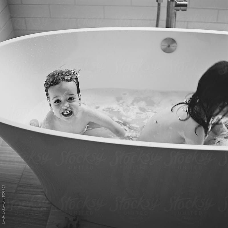 Cute young boy in a large bath tub by Jakob for Stocksy United