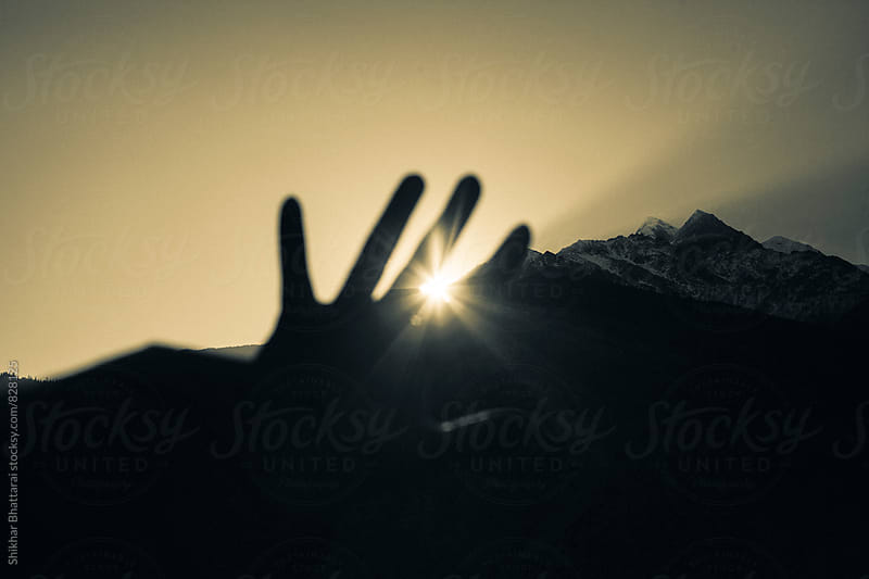 Feeling the warmth of the first rays of the sun. by Shikhar Bhattarai for Stocksy United