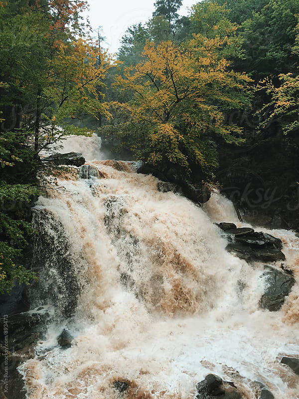 Flooding Waterfall in Autumn by Kevin Russ for Stocksy United