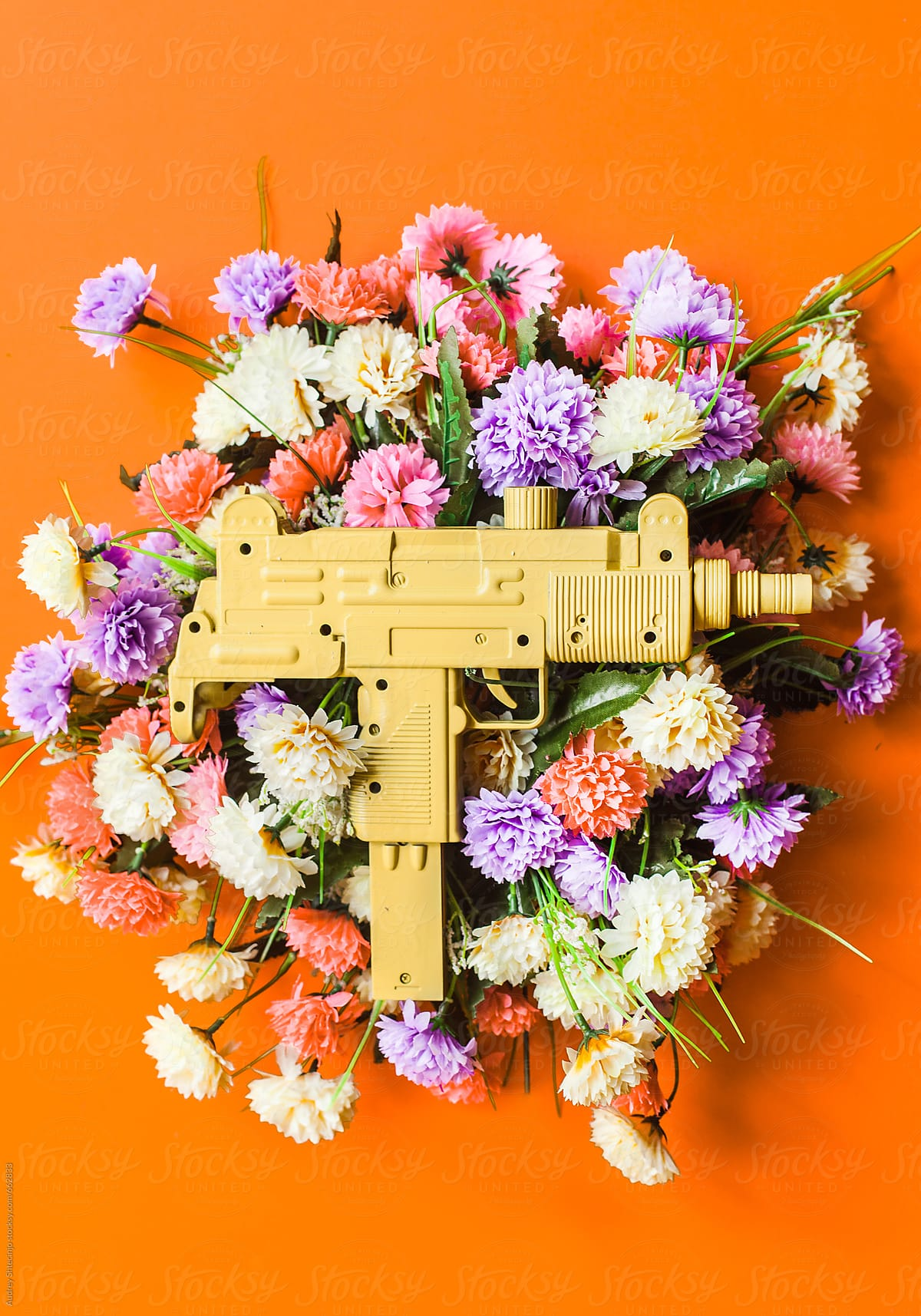 Uzi Machine Gun On Colorful Flower Bouquet. | Stocksy United