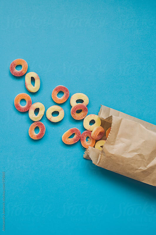 Colorful gummies on the blue background by Aleksandra Jankovic for Stocksy United