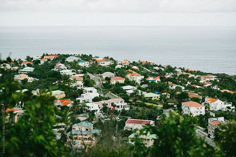 Island neighborhood overlooking the ocean by Lina Kiznyte for Stocksy United