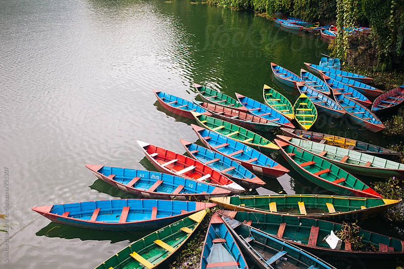 Colorful boats on the shore of Fewa Lake, Pokhara,Nepal. by Shikhar Bhattarai for Stocksy United