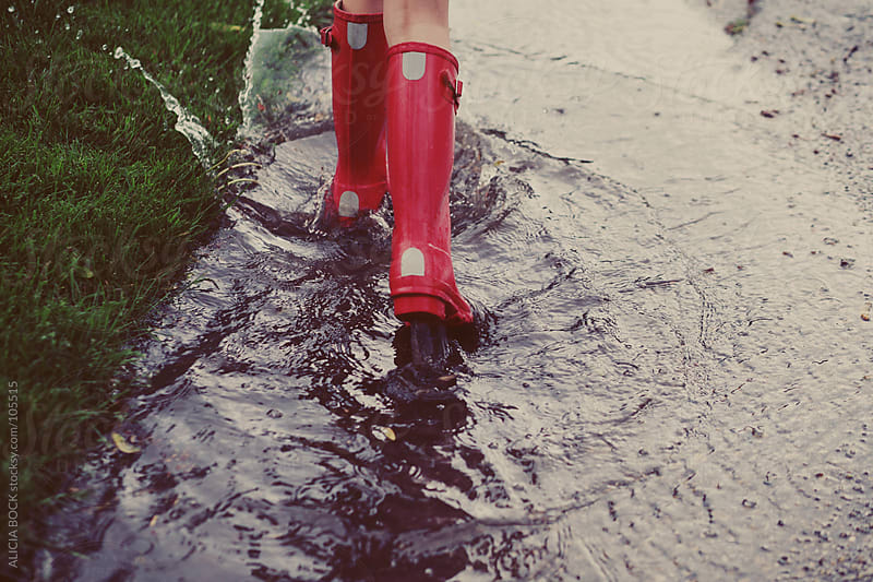Splashing in a Spring Puddle by ALICIA BOCK for Stocksy United