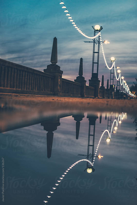 reflected street lights by Javier Pardina for Stocksy United